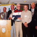 Mie Waki (Japan) presenting participants who have attended at least 10 WALG tournaments. L – R Doug Crosby (Aust), Peter Nolan (Aust), Ken Ahrens (USA), John Hodecker (USA), Peter Read (Aust) and Nigel Osborne (N.Z.) Canada 2003